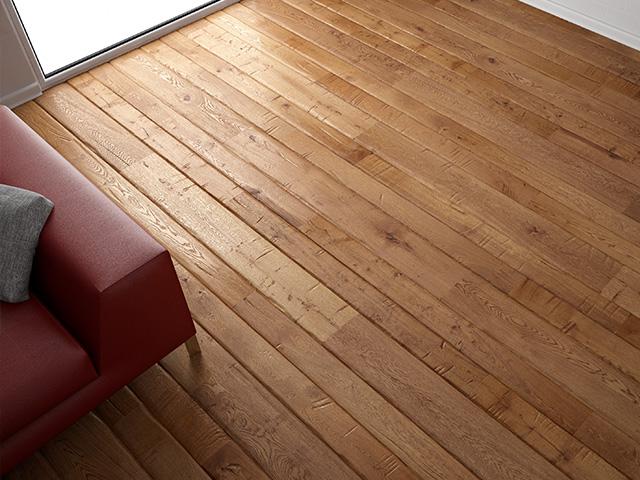 Vue d'un salon avec plancher en bois avec un fauteuil