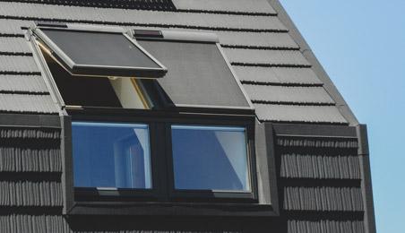 Velux avec balcon sur un toit mansardé
