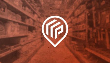 Logo Point.P sur fond de racks produits sous filtre orange